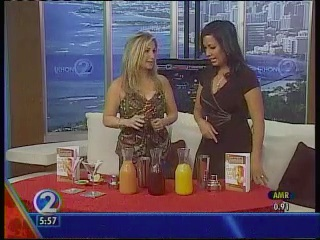 Party Girl Diet Author Aprilanne Hurley with KHON-2 Co-Anchor Oleana Hue shake things up literally on the set.